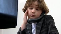 Child boss on telephone - stock footage