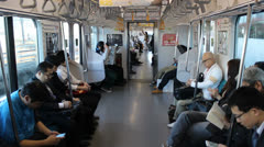 TOKYO - CIRCA MARCH 2013: Interior of a Tokyo subway car Stock Footage