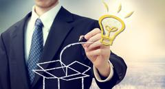 business man with idea light bulb coming 'out of the box' - stock photo