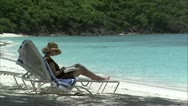 Stock Video Footage of Zoom out lady on sun lounger