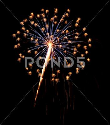 Stock photo of A burst of Fireworks in the night sky.