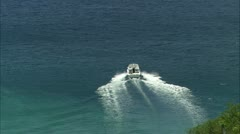 Zoom out from speed boat to view Guana Stock Footage