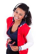 young black  african american teenage girl  listening to music - african peop - stock photo