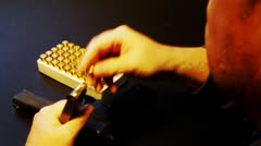 Man Loads Bullets Into Clip Inserts Clip Into Handgun Pistol Stock Footage