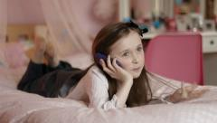 Child Chatting on Phone Stock Footage