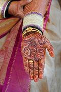Bride's hand with henna and bangles Stock Photos