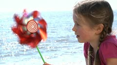 Child with pinwheel Stock Footage
