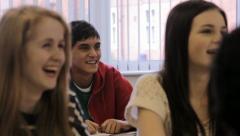 High school student raises hand Stock Footage