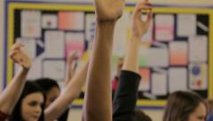 Raising hands in class - stock footage
