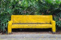 Yellow bench in garden Stock Photos