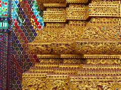 golden engraved stucco decoration in buddhist vihara in thailand - stock photo