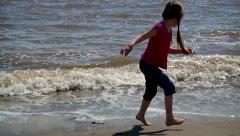 Child on beach Stock Footage