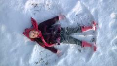 Snow angel Stock Footage
