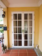 double patio white french doors with windows on yellow wall - stock photo