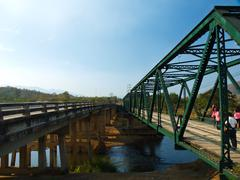 historical and concrete bridges over the pai river in mae hong son, thailand - stock photo