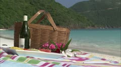 Still shot of picnic basket on the beach Stock Footage