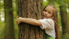 Hugging a tree Stock Footage