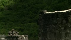 Zoom out to ruins by lake, Guana Stock Footage