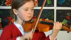 Child plays violin Stock Footage