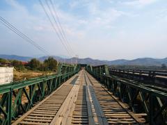 historical bridge over the pai river in mae hong son, thailand - stock photo