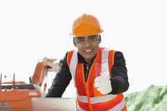 Road construction worker using laptop Stock Photos