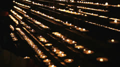 Burning candles in the St. Stephan cathedral, Vienna, Austria Stock Footage