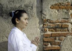 asian woman greets in temple, sawasdee - stock photo