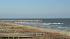 Pier in rough surf Stock Footage