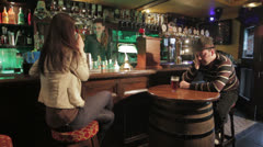 Depressed man drinking in a bar,pub Stock Footage