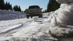 Truck Driving on Snow Road Dolly Left Low Angle slowmo Stock Footage
