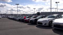 New Cars at Auto Dealership, in Parking Lot Stock Footage
