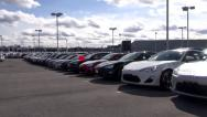 Stock Video Footage of New Cars at Auto Dealership, in Parking Lot