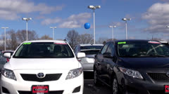 New Cars at Auto Dealership, in Parking Lot - stock footage
