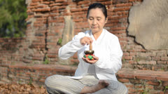 Woman playing a tibetan bowl Stock Footage