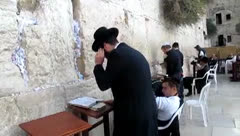 Orthodox Jewish worshipper are praying at the Wailing Wall. Jerusalem Stock Footage