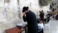 Orthodox Jewish worshipper are praying at the Wailing Wall. Jerusalem Stock Footage