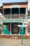 Boots house in wild west style Stock Photos