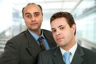 Stock Photo of two business men standing at the office