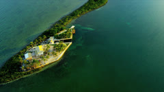 Aerial view small sub tropical Island, USA Stock Footage