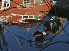 Flooding Fisherman facade - stock photo