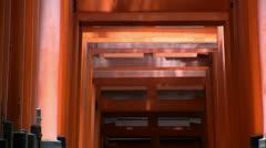 Fushimi Inari Shrine Tori Gate walkway (zoom out) Stock Footage