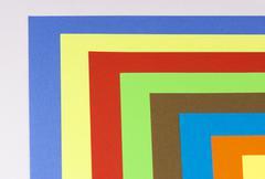 spectrum of multicolored paper - stock illustration