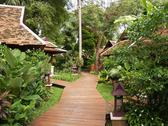 Stock Photo of wooden walkway and bungalows in thailand