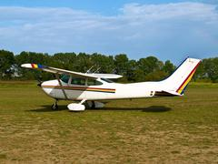 light aircraft landed in grass - stock photo