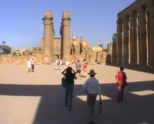 Tourists walking along courtyard in Karnak Stock Footage