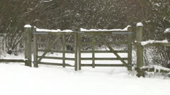 Snowy Wooden Fence Gates in Countryside Stock Footage