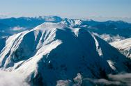 Mountain top covered in snow, aerial view Stock Photos