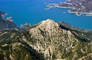 Rocky mountain top near lake, aerial view Stock Photos