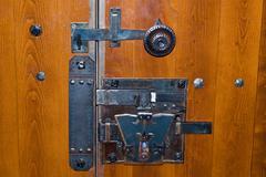 Old iron lock on wooden door Stock Photos
