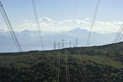 high voltage power lines and towers. - stock photo